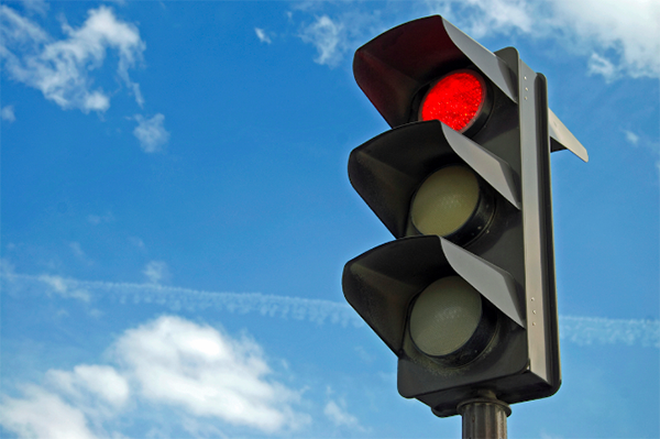 You will receive a traffic ticket for running a red light in Las Vegas, Nevada.